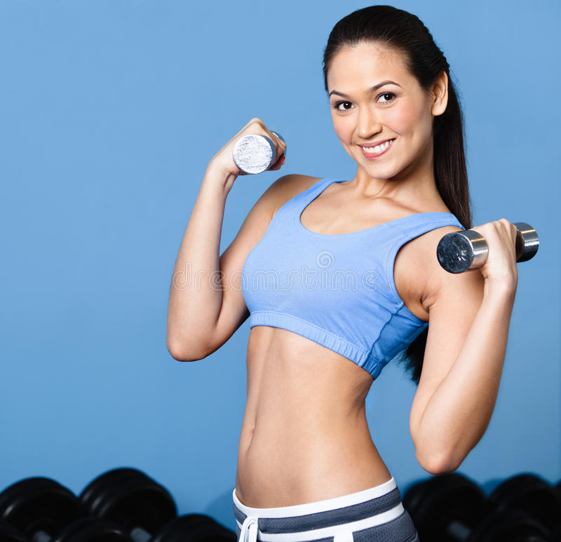 Download Woman Exercises With Dumbbells Stock Image - Image: 26548371