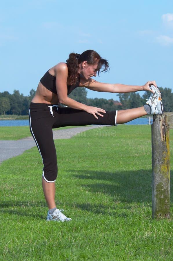 Woman exercising. Outdoor stock photos