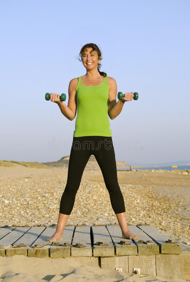 Download Woman Exercising On Beach. Royalty Free Stock Photo - Image: 21963235