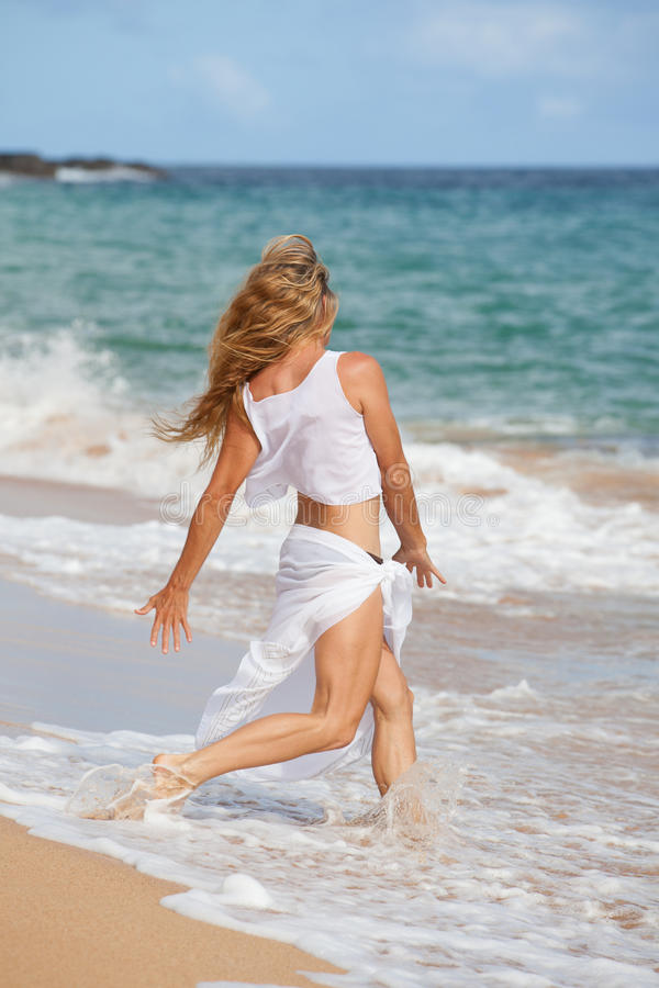 Woman exercising on the Beach royalty free stock image