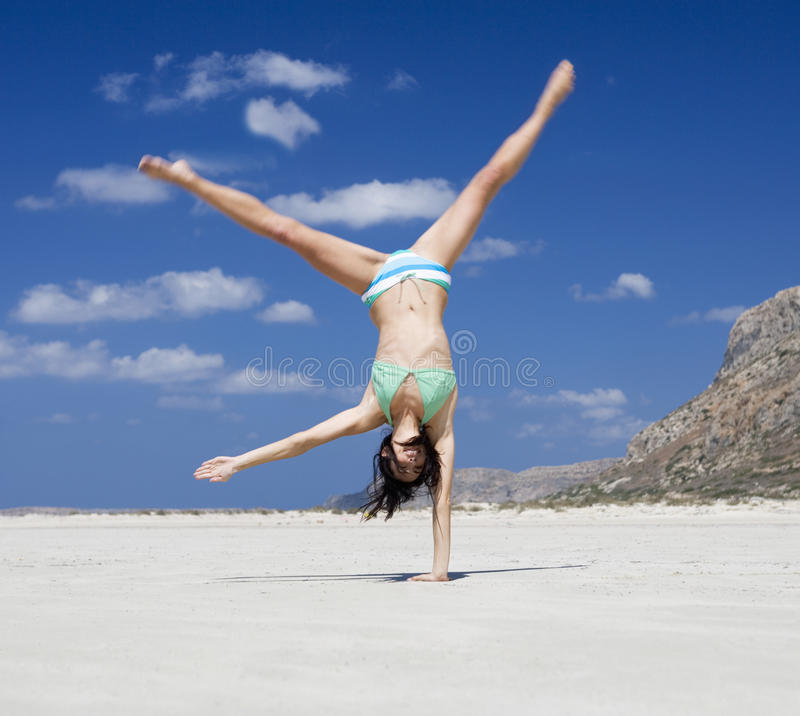 A woman exercising on a beach stock photography