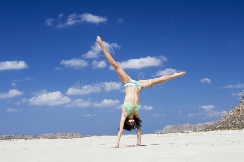 A woman exercising on a beach royalty free stock photos