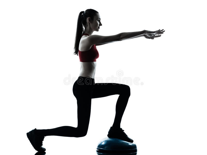 Woman exercising bosu balance ball trainer stock photography