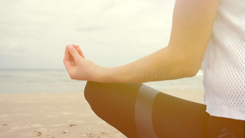 Woman exercising deep breathing relaxation meditation stock photography
