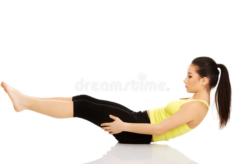 Woman exercising and doing a crunch. stock images