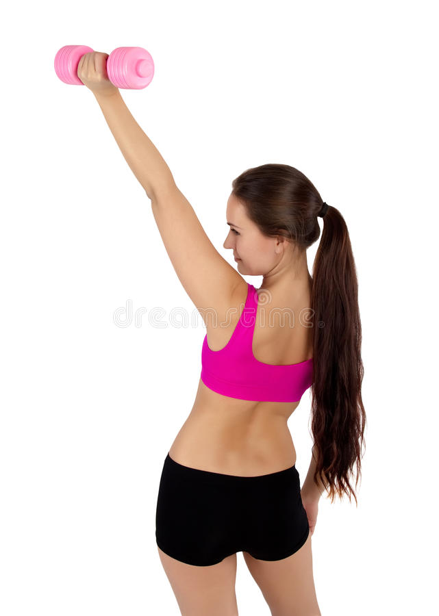 Woman exercising with dumbbell royalty free stock images