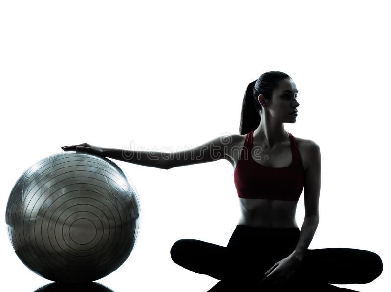 Woman exercising fitness ball stock photos