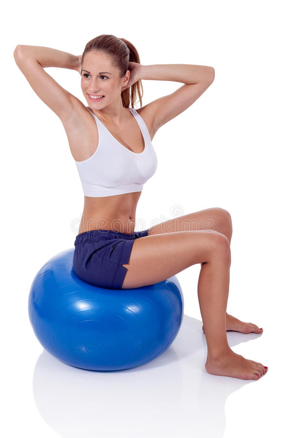 Woman exercising on a fitness ball stock image