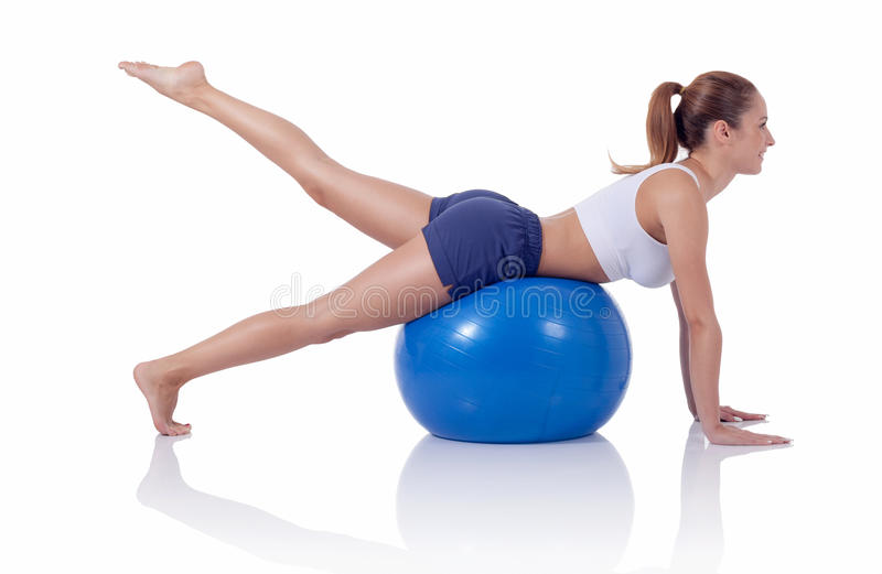 Woman exercising on a fitness ball royalty free stock images