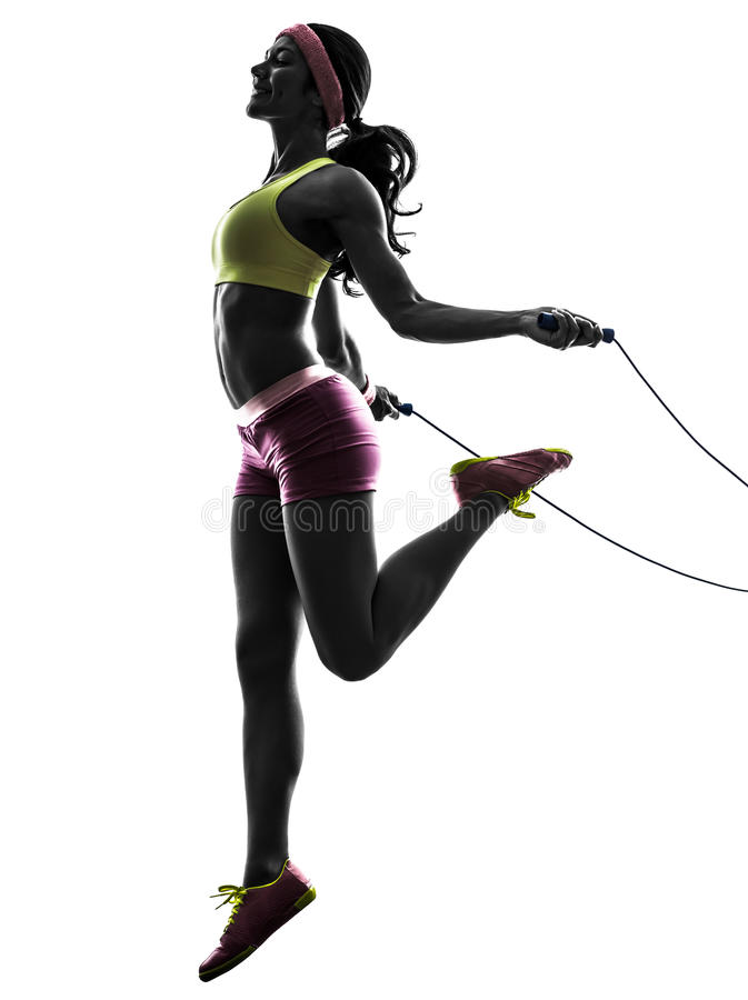 Woman exercising fitness jumping rope silhouette. One caucasian woman exercising fitness jumping rope in silhouette on white background royalty free stock photography