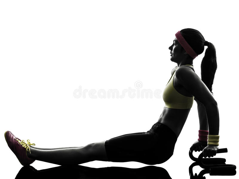 Woman exercising fitness push ups with holders silhouette stock photo