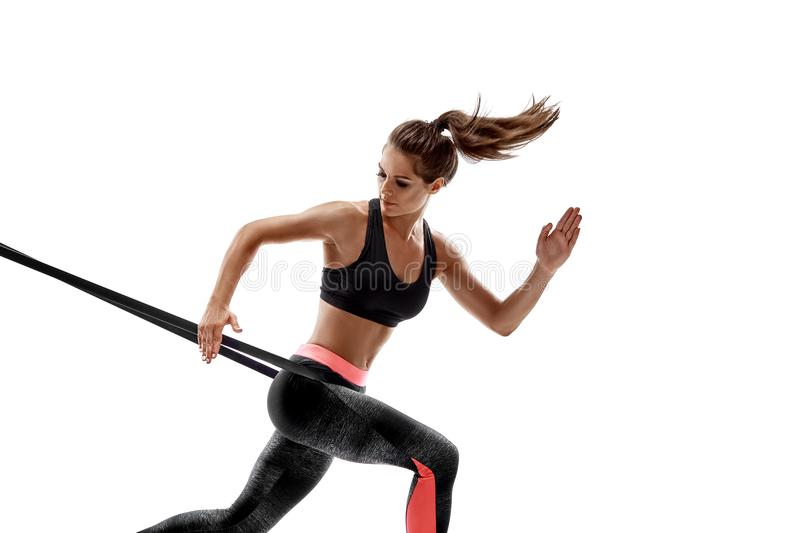 Woman exercising fitness resistance bands in studio silhouette isolated on white background. One caucasian woman exercising fitness resistance bands in studio royalty free stock photography