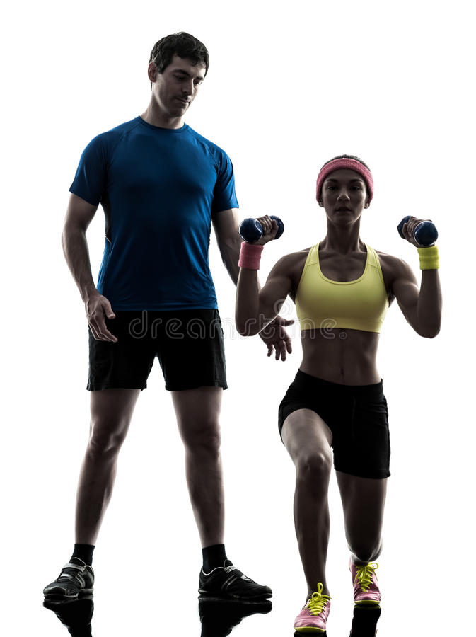 woman exercising fitness weight training with man coach silhouette royalty free stock image