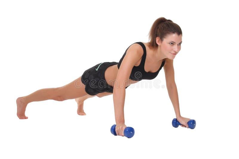 Woman exercising fitness workout push ups. Beautiful sports woman exercising fitness workout push ups stock photos