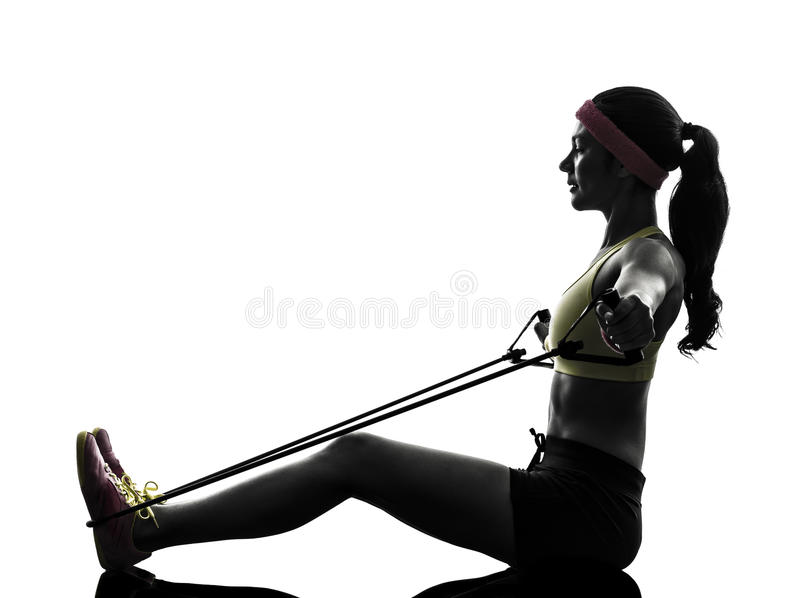 Woman exercising fitness workout resistance bands silhouette stock photography