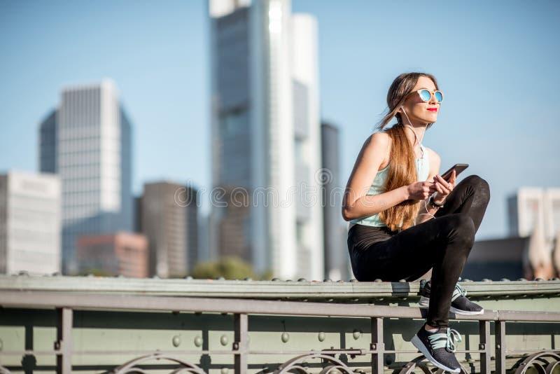 Woman exercising in Frankfurt city stock photo