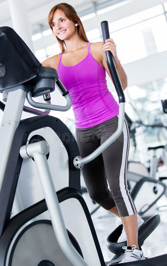 Download Woman Exercising At The Gym Stock Photo - Image: 26094138