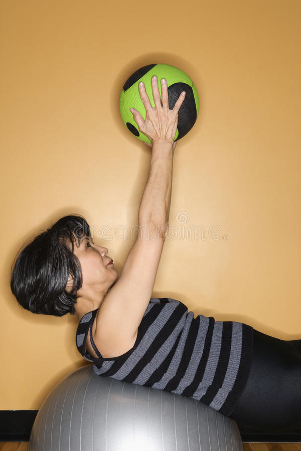 Woman Exercising with Gym Balls stock image