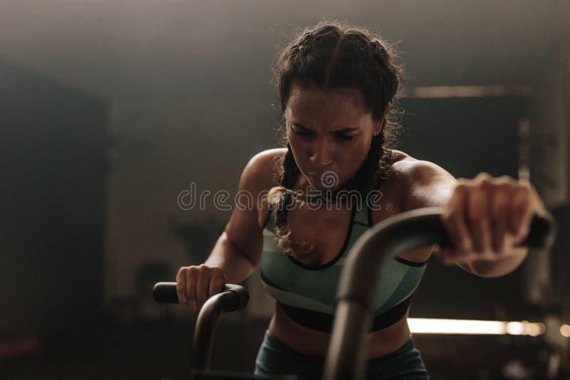 Woman exercising gym bike royalty free stock photo