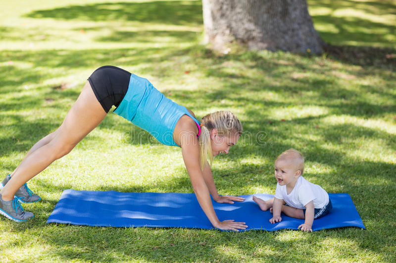 Woman exercising with her baby royalty free stock photos