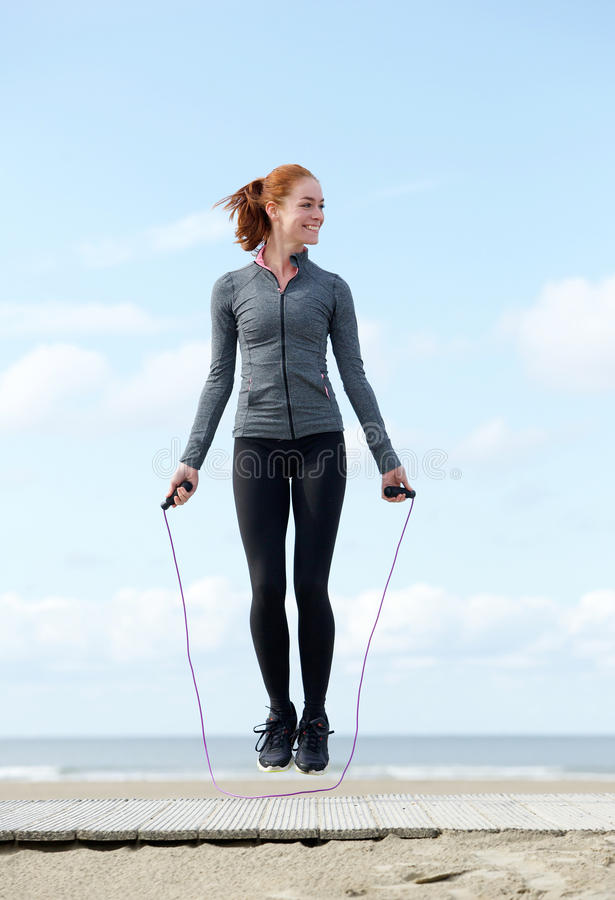 Woman exercising with jump rope outdoors royalty free stock images