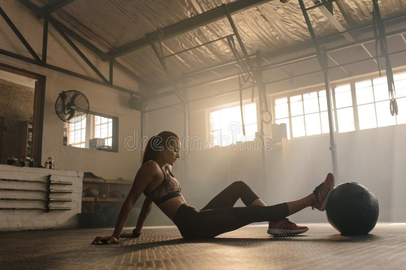 Woman exercising with medicine ball royalty free stock images