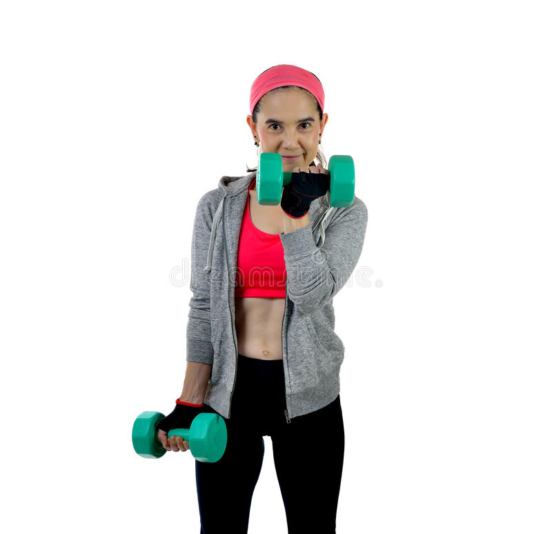 Woman exercising. Middle aged woman exercising with dumbbells isolated on white background royalty free stock photography