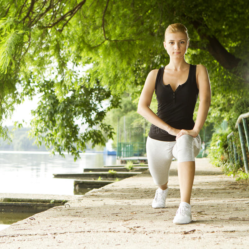 Woman exercising outdoor royalty free stock images
