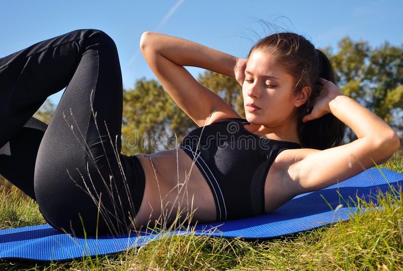 Woman exercising outdoors royalty free stock photos