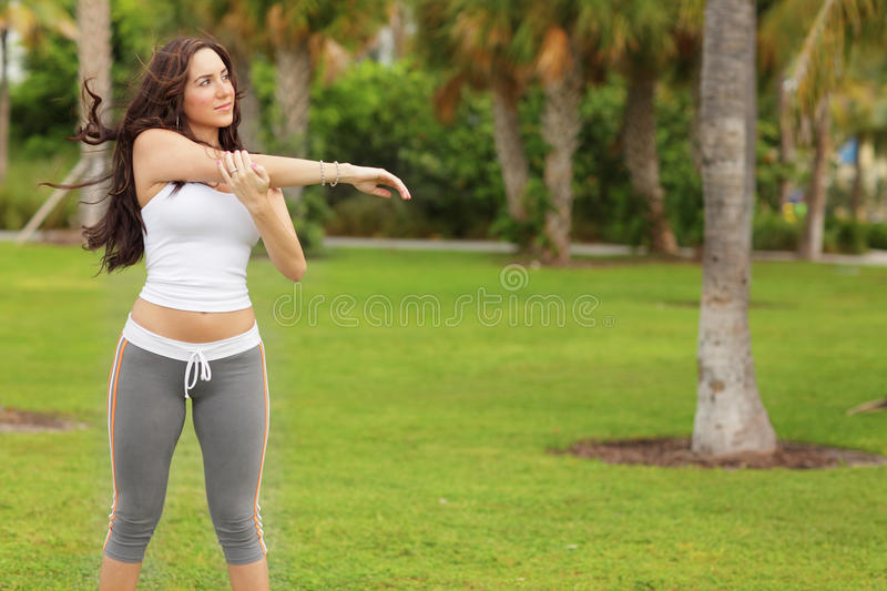 Download Woman Exercising In The Park Stock Photo - Image of being, nature: 21513478
