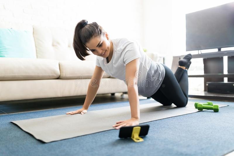 Woman Repeating Exercises While Watching Online Workout