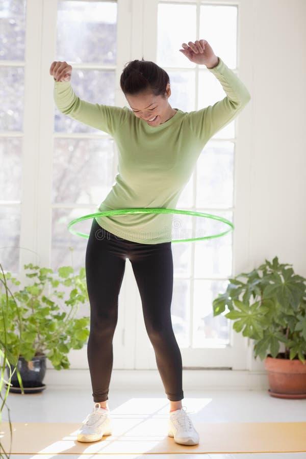 Free Woman Exercising With Hula Hoop Royalty Free Stock Photo - 10283555