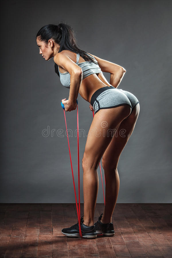 Free Woman Exercising With Rubber Tape Royalty Free Stock Photo - 50238775