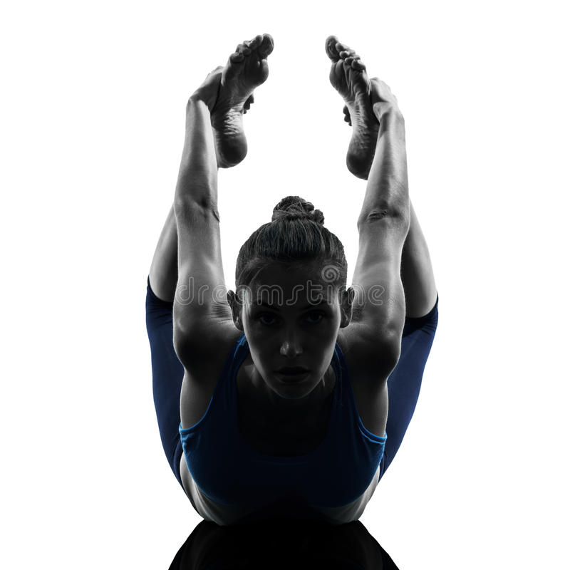 Woman Exercising Yoga Bow Pose Stock Images