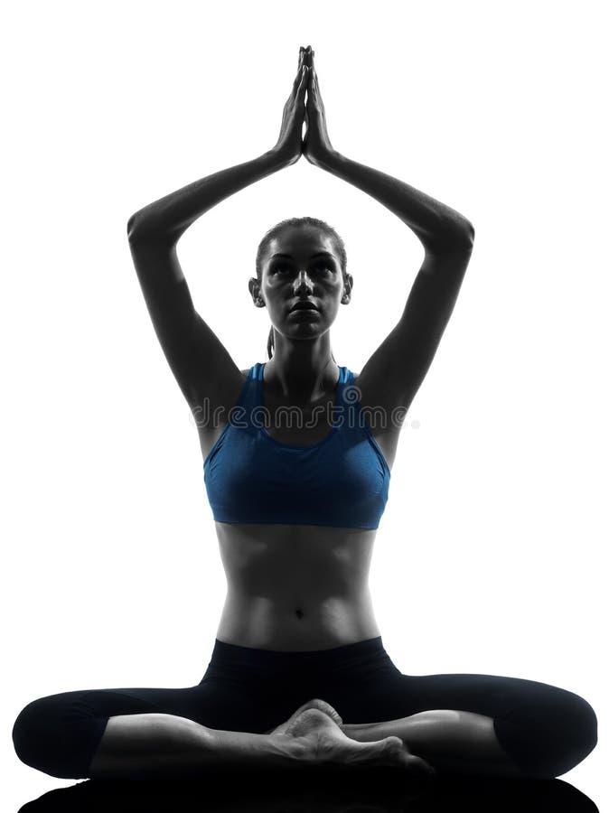 Woman exercising yoga meditating royalty free stock photos