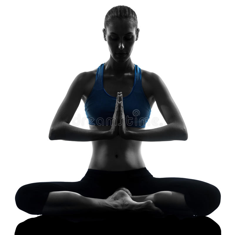 Woman exercising yoga meditating sitting hands joined stock photography