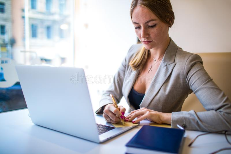 Woman experienced business plan writer preparing to meeting with partner stock photo