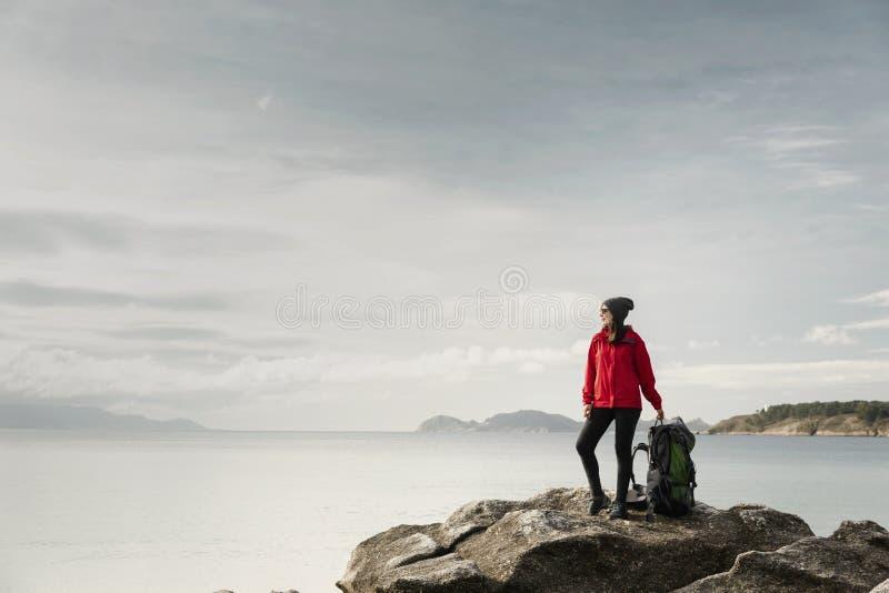 Woman exploring the coast royalty free stock image