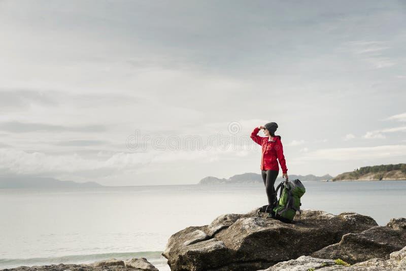 Woman exploring the coast stock photos