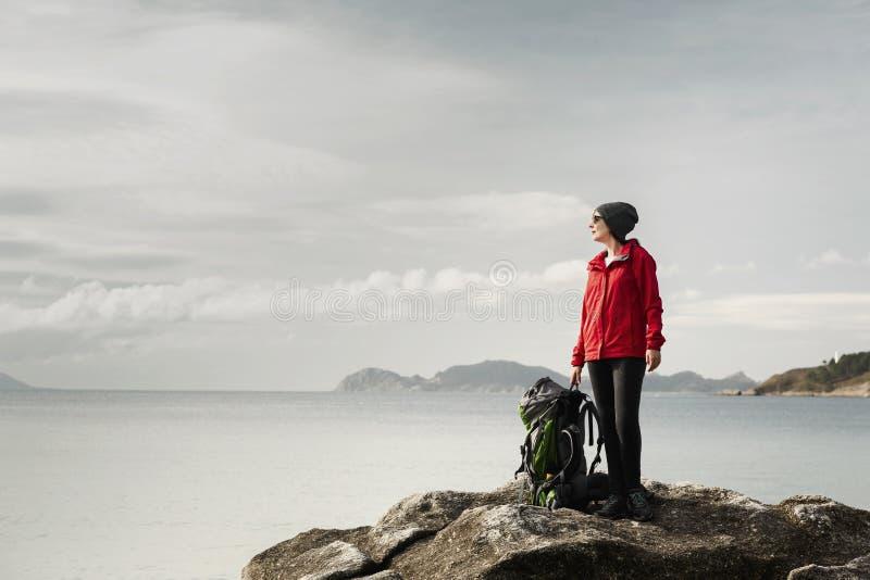 Woman exploring the coast royalty free stock photography