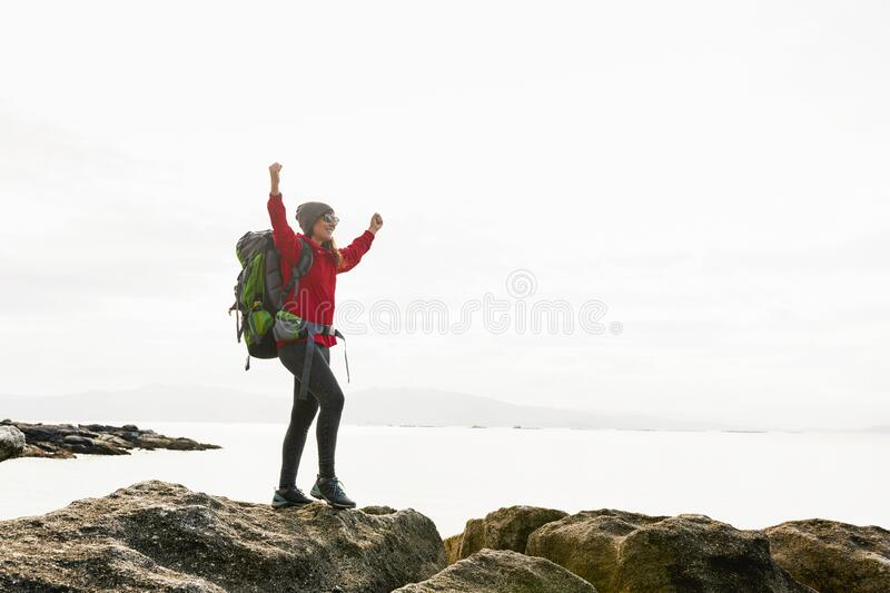 Woman exploring the coast royalty free stock images