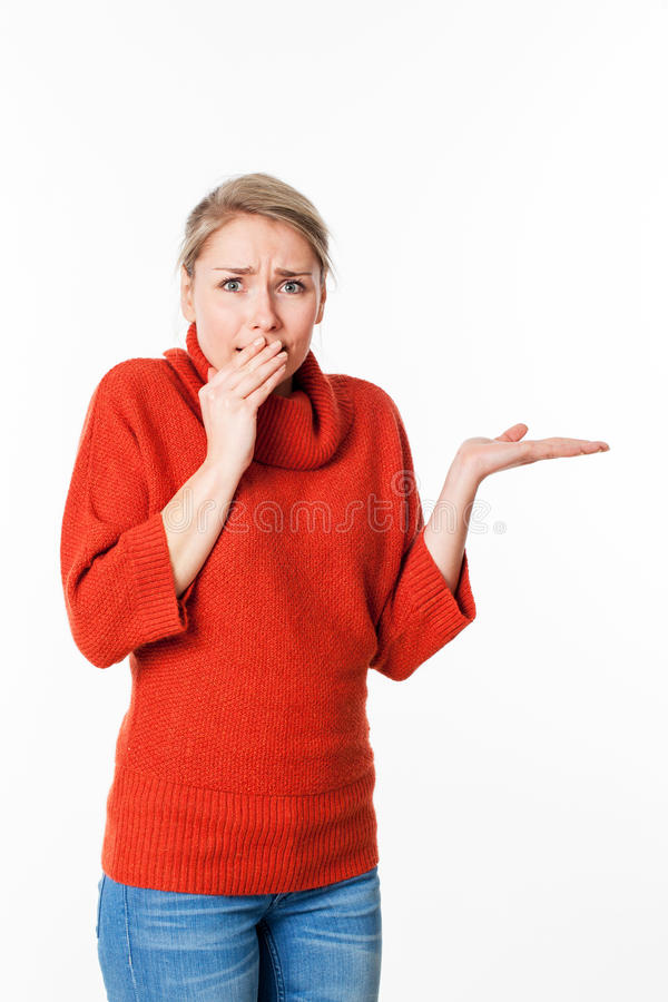 Woman expressing fear and apprehension in holding secret. Copy space concept - scared young woman expressing fear and apprehension in holding something secret in royalty free stock photography