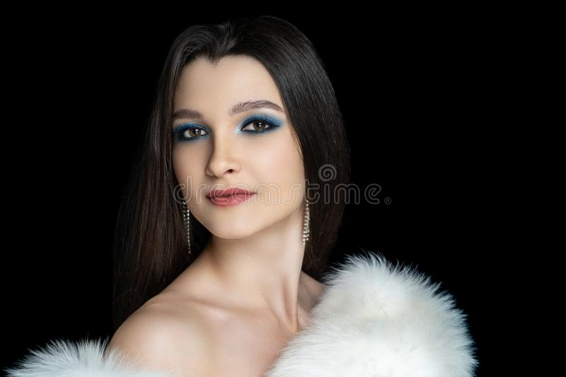 Woman Expressive look over shoulder. Beautiful woman close portrait. Professional make up glossy eyeshadows, long lashes, new matte lipstick. Elegant hair style stock photo