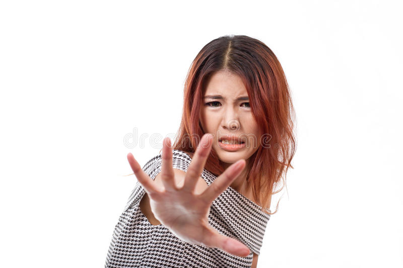 Woman with extremely fearful mood showing stop, reject, refuse. Forbid, negative hand sign stock image