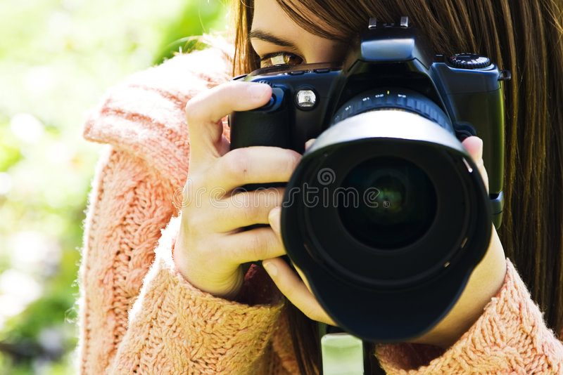 Woman eye behind camera stock image