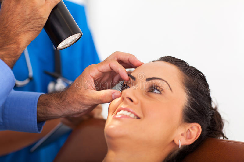 Woman eye checkup. Woman in for eye checkup in doctor's office stock image