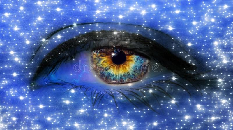 Woman eye close-up macro with long eyelashes and professional blue make-up with stars in blue neon light stock images