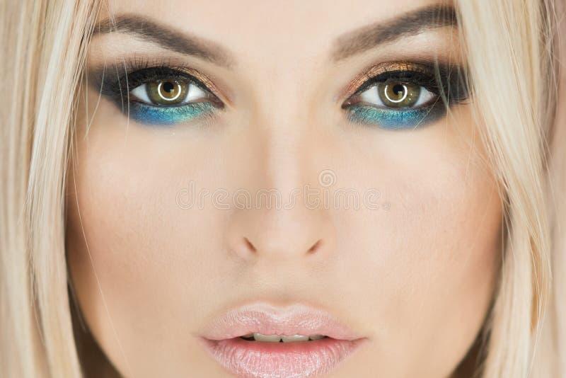 Woman with eye color, makeup face, beauty stock photos