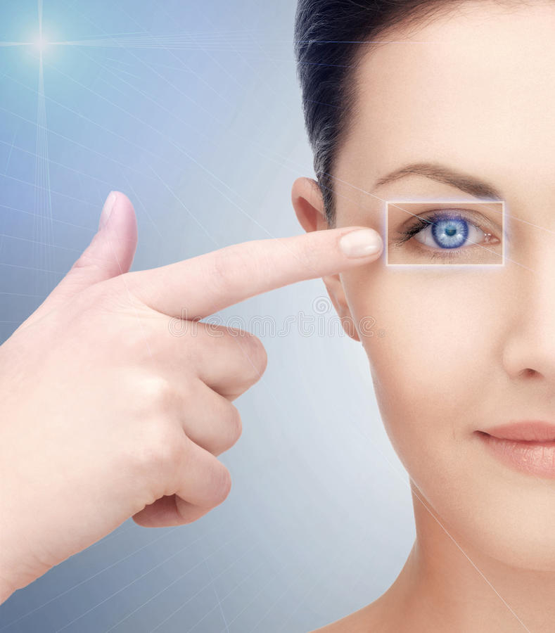 Woman eye with laser correction frame. Health, vision, sight, future technology concept - woman eye with laser correction frame stock photo