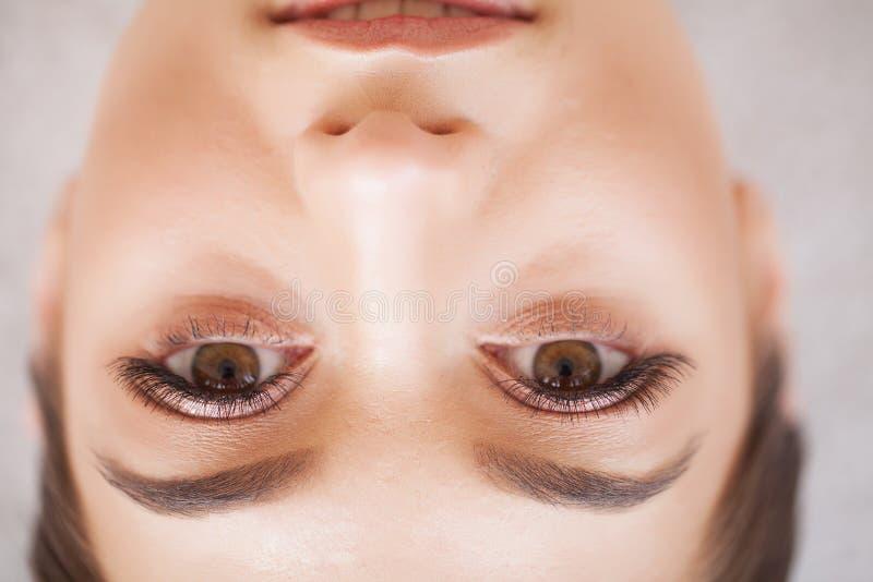 Woman Eye with Long Eyelashes. Beautiful Young Woman During Eyelash Extension royalty free stock photos